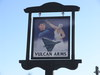 The signboard of the Vulcan Arms in Sizewell Gap.