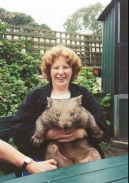 AE29	Sam holding a wombat at the wildlife reserve